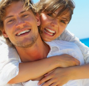 Smiling couple with nice teeth from tooth replacement dental implants in Boise